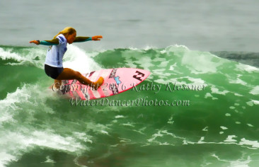 Pink Board Surfer Girl off the lip.
